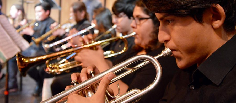 TRUMPETING BLACK HISTORY: Samuel Arias, right, and the rest of the brass section, pay tribute to African-American songwriters at the Black History Concert in the Hubbard Auditorium on Friday, February 2.