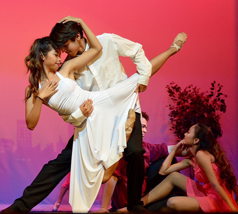 DANCING THE NIGHT AWAY: Gabriella Santos and Jordan Springs share a close moment at the Dance Spectacular.