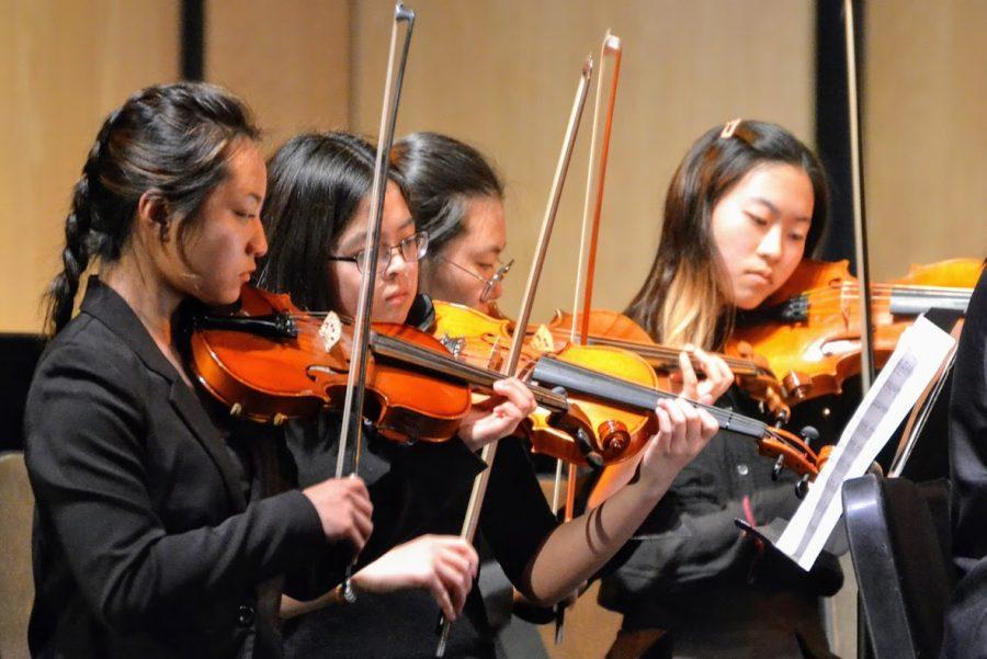 Roselyn Poommai, Gyujin Hong and Sharon Nah performing during the concert.