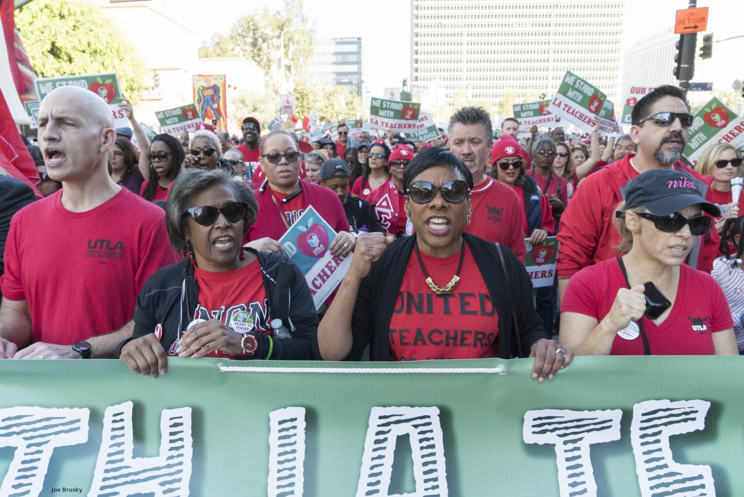 LAUSD teachers march in protest for increasing benefits.