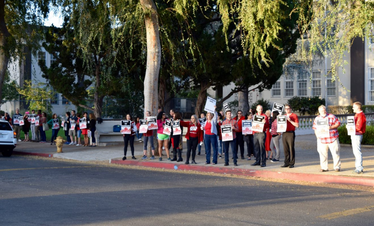 Van Nuys' teachers picket in front of the school. A repeat of this scenario is highly probable on January 14.