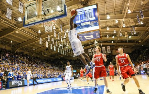 Zion Williamson mid-jump in a game against Hartford University.