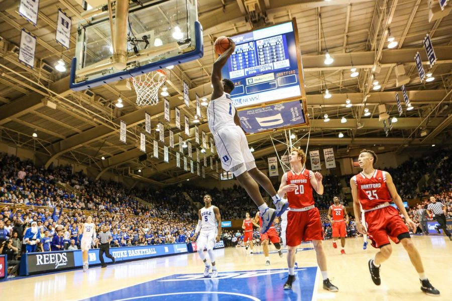 Zion+Williamson+mid-jump+in+a+game+against+Hartford+University.+