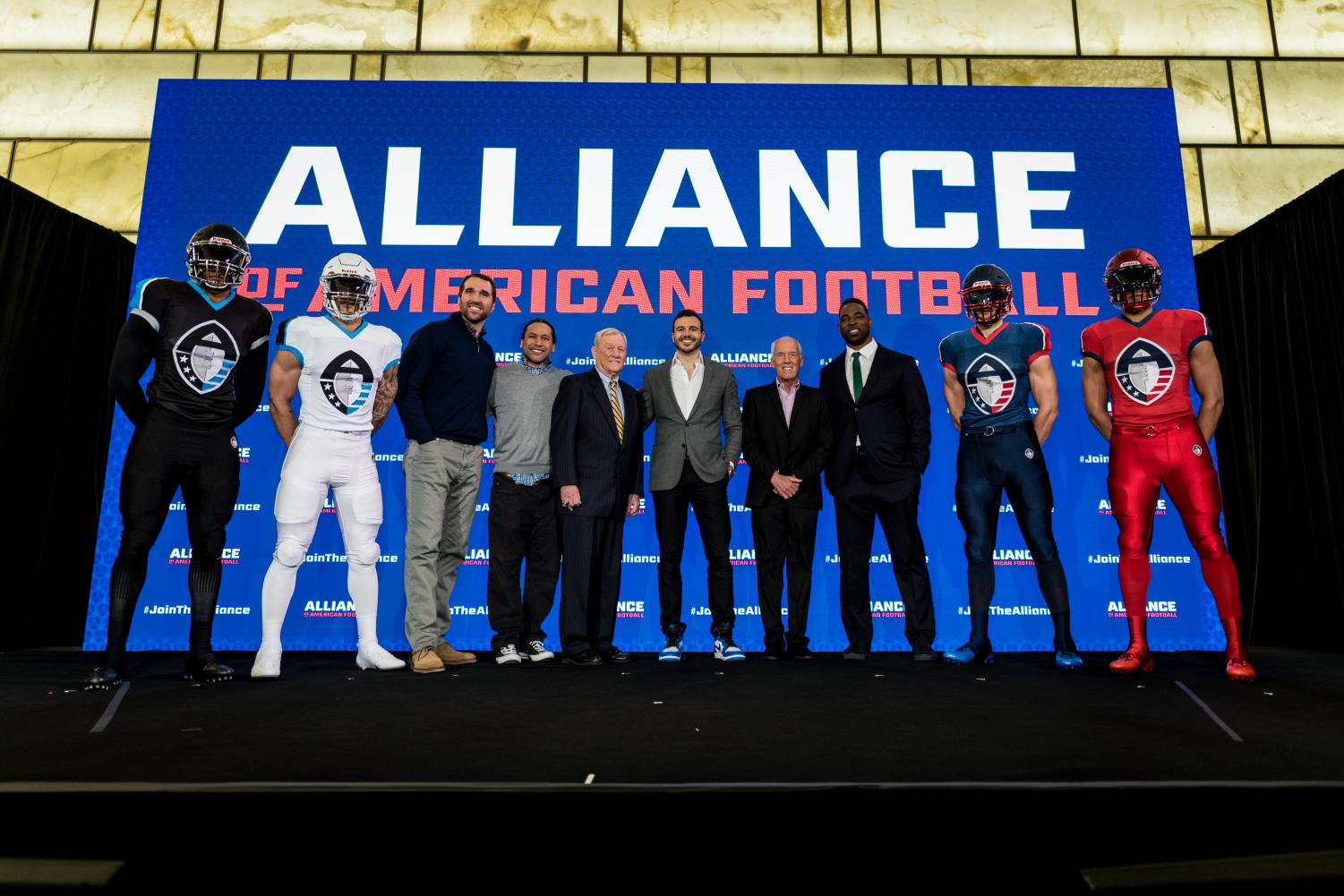 Founders and members of the Alliance of American Football pose for the press.