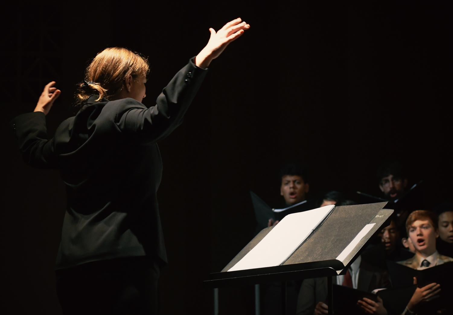 Brianne Arevalo conducts her vocalists.