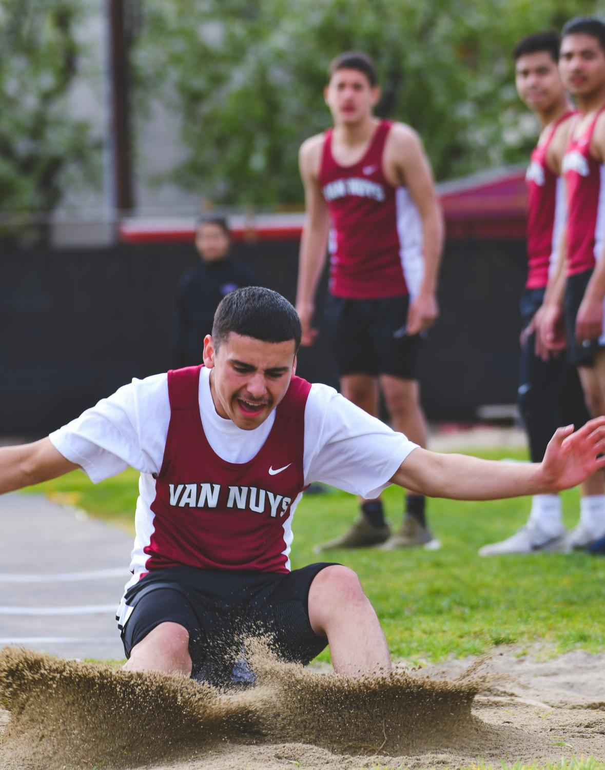 Jumping to the finish line, Bryan De La Hoya competes in the long jump at the first home meet.