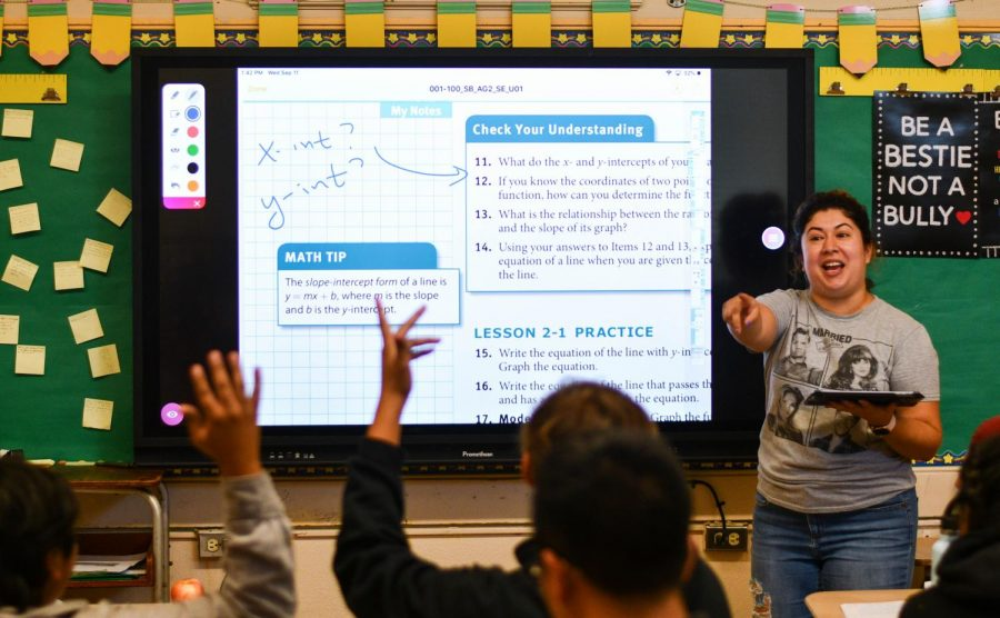 Math+teacher+Ms.+Medrano+using+the+Promethean+Board+during+instruction.+