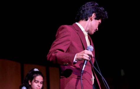 As the sun comes down the moon comes up, Enrique Berganza, preps his mic and gets ready for the Fall concert at Van Nuys High School on Oct. 18, 2019.