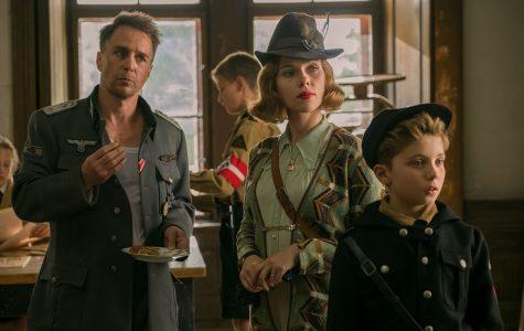 Captain Klenzendorf (Sam Rockwell) with Rosie (Scarlett Johansson,) Jojo's (Roman Griffin Davis) single mother and Jojo in the film Jojo Rabbit.