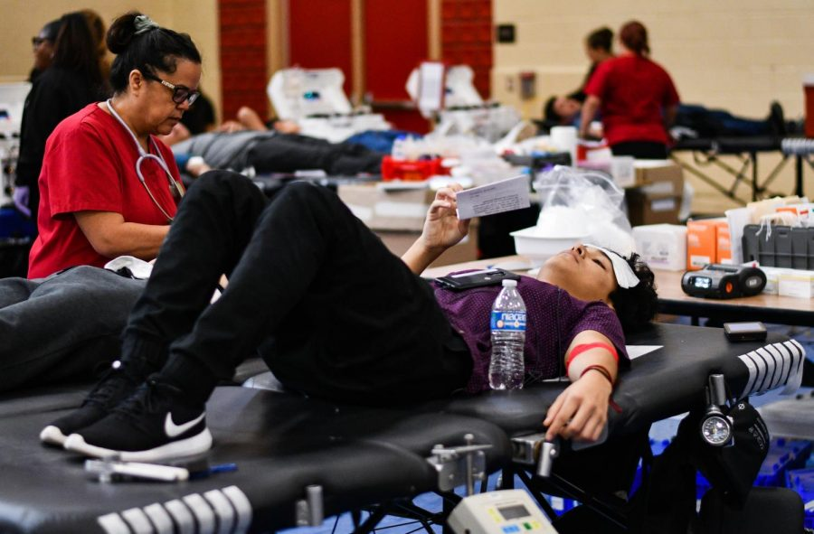 Volunteering to be part of the annual blood drive on Nov.19, 2019, Joshua Gonzalez, lays on the stretcher while waiting for blood to be drawn out of him.