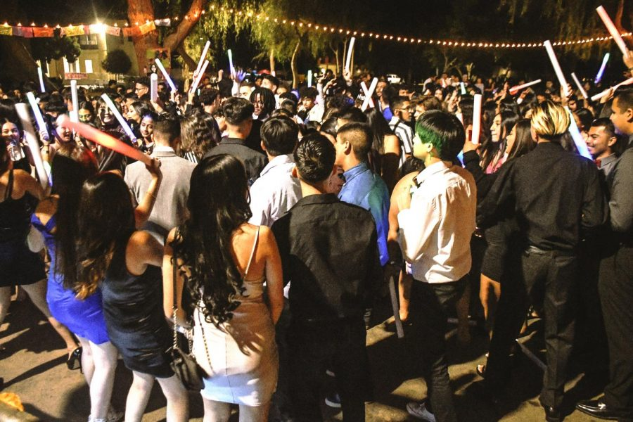 Students partying together in a tight hundle during the last homecoming dance hosted at school pre-pandemic on Nov. 2, 2019.