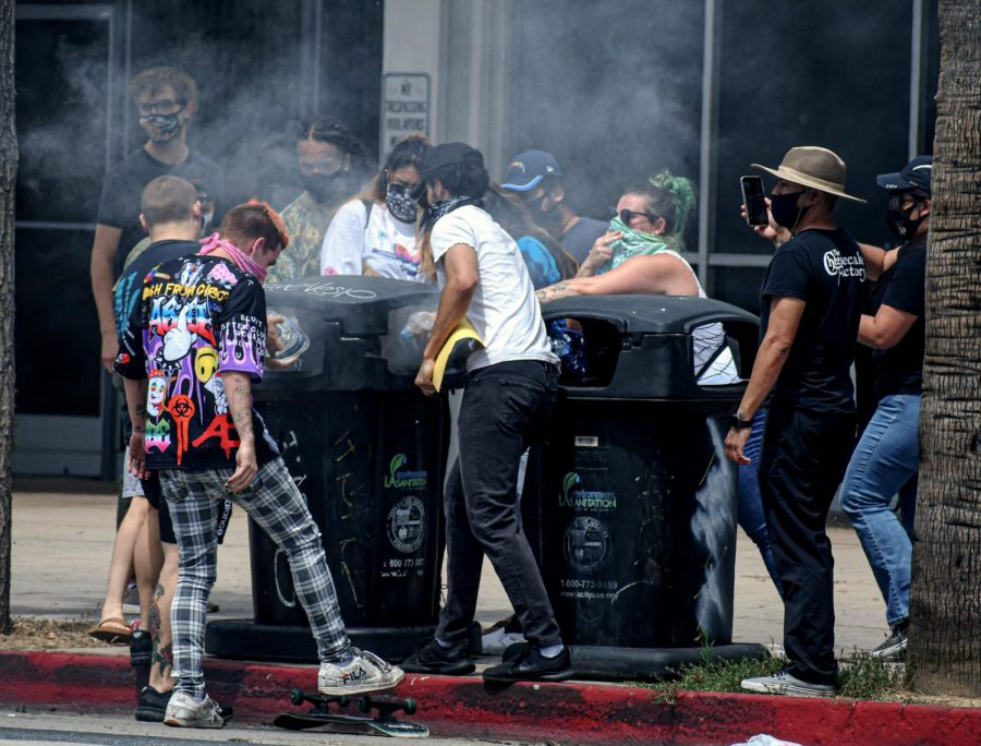 Protestors put out a fire inside a trash can at Van Nuys Blvd. on June 1st.