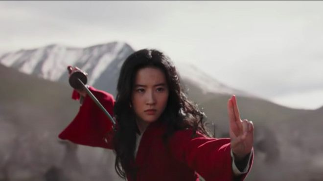 Mulan in a pose, wielding a sword, preparing for battle.