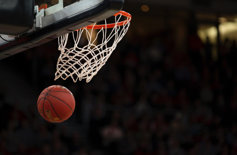 Basketball shot into hoop.
