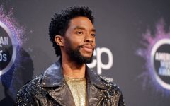 Chadwick Boseman  poses at the American Music Awards