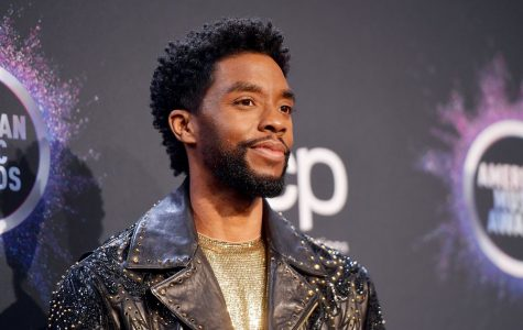 Chadwick Boseman  poses at the American Music Awards