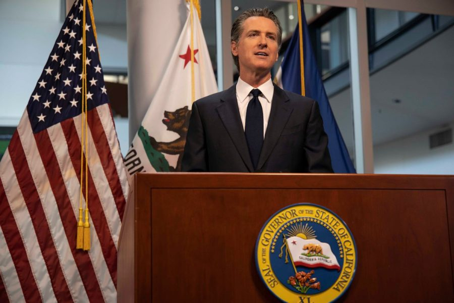 Gavin+Newsom+speaking+during+a+news+conference