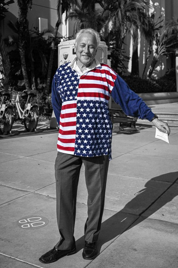 A voter shows off his American Flag shirt to represent his proudness to vote under the name of democracy in Beverly Hills City Hall on Election Day. (NOV 3, 2020)