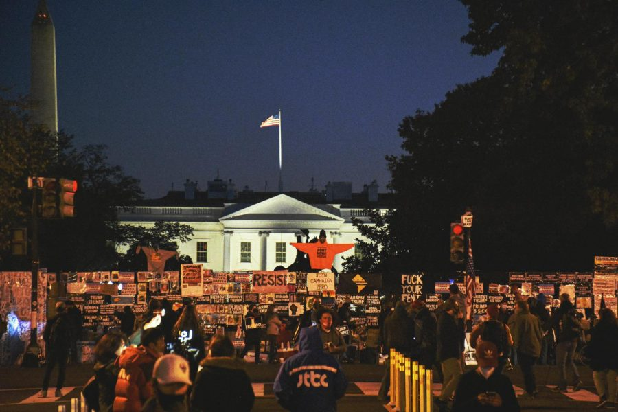 Protesters gather up to put signs on the White House's fence in Washington D.C. on Election Day. (NOV 3, 2020)