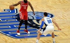 Former Rockets guard and MVP James Harden sets up offense against Aaron Gordon. Harden was traded to the Brooklyn Nets for the 2021 season.