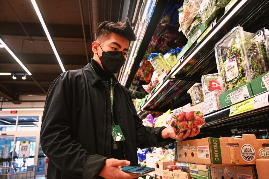 UCLA student Jan Martinez is completing a delivery order at Aldi. He was forced to start using the delivery platform Instacart as another form to generate income due to losing his job to the overwhelming economic recession on small businesses. NORTHRIDGE, LOS ANGELES FEBRUARY 17TH, 2021.