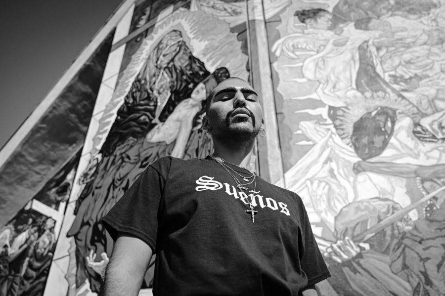 "Eliseo Equihua is posing for the Latino brand ""SUEÑOS"" to represent LGBTQ+ inclusivity in the Latine ""Hood Culture"