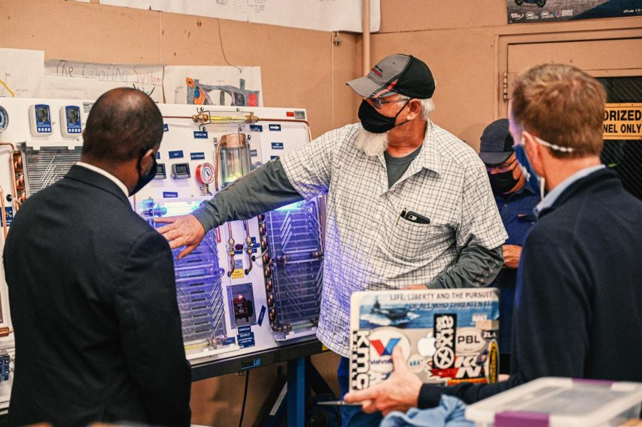 Autoshop teacher Joseph Agruso (Center) is demostrating Superintendent Austin Beutner (Right) and Superintendent Tony Thurmond (Left) on how he teaches his students on the working process of a car air conditioning system in his autoworks class.