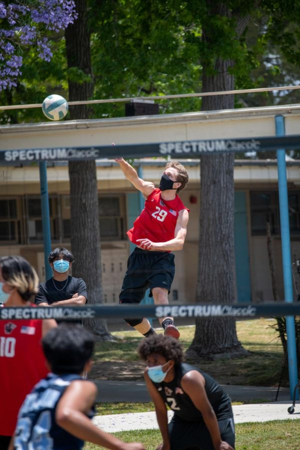 Team Captain Jake Stanley sending his signature jump serve scoring multiple aces across the season.