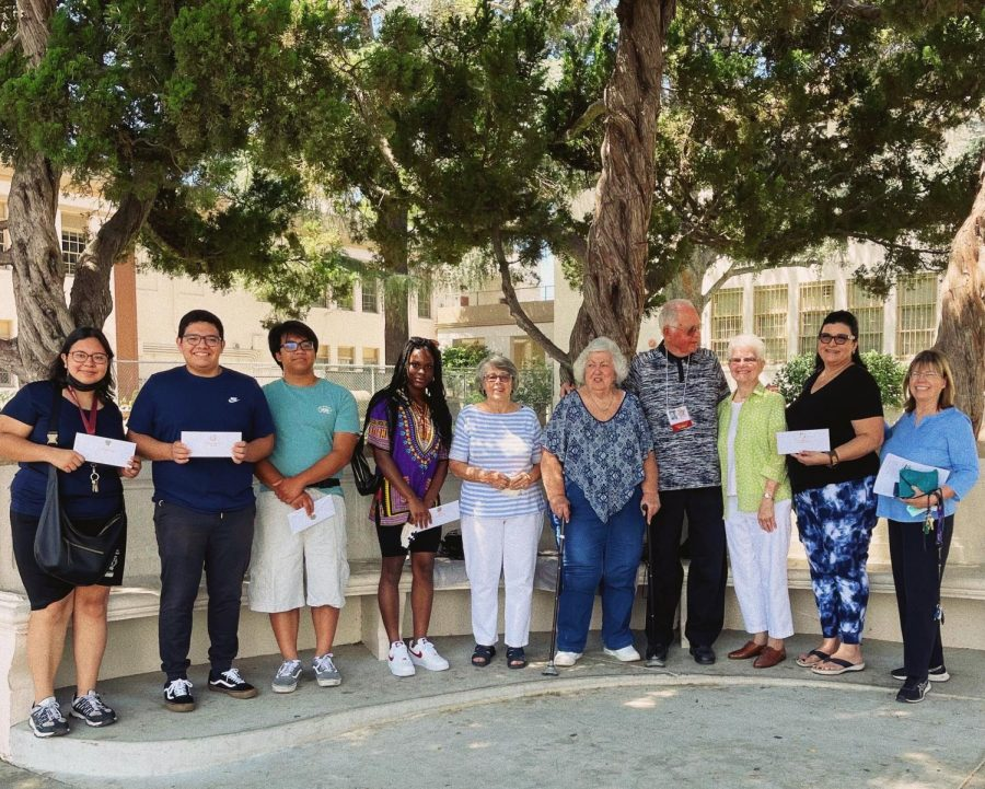 Six graduates from the Class of 2021 came to school to accept $1000 scholarship grants from alumni from the class of 1957.