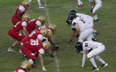 Taft Offensive line prepares to snap the ball to their quarterback against the black and white defenders. The Wolves were unable to contain the offense and lost the game with a final score of 43-6.