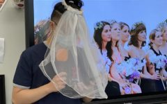 Wearing a white wedding veil, AP Research student Marvin Ocampo performs his wedding vows to marry his research topic of eye care in LAUSD students for the year.
