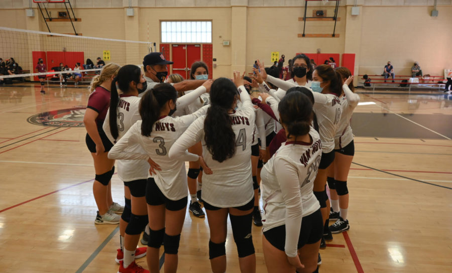 3, 2, 1 GO WOLVES! All hands in for Girls volleyball as they prepare to start their next set.