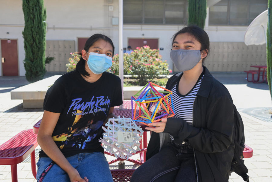 Two of the egg survivors (from left to right: Jazmin Alejandre and Breanna Kiarra) holding their successful designs from the egg massacre. The test was conducted by Physics teacher Mr. Manzano on Sept. 21.
