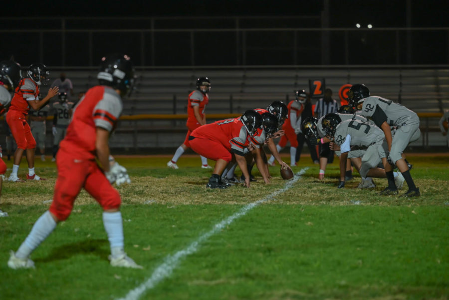 Van Nuys gets ready to snap the ball for the homecoming game. With a loss of 35-8, this will be the third home game loss of the season.