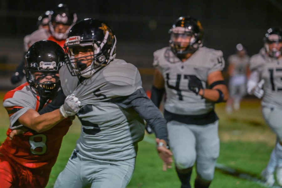 Abraham Melero grabs a Panorama player in an attempt to tackle him.