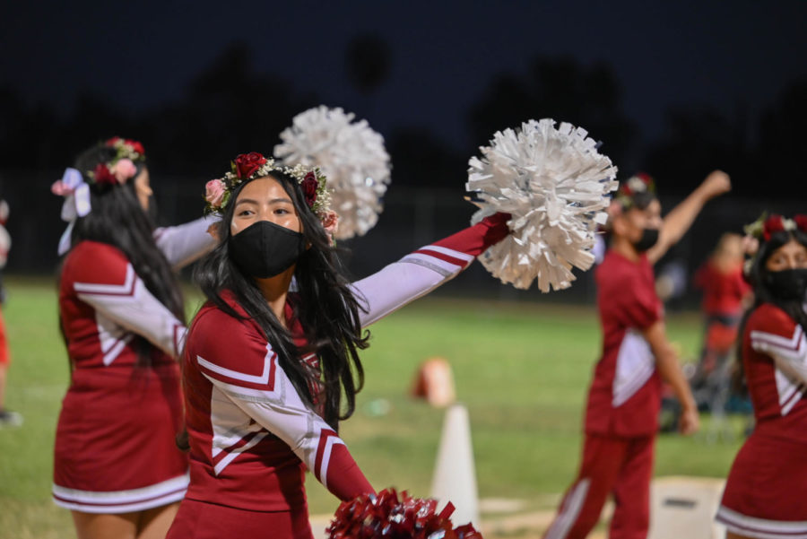 Junior Cheerleader Kyla Villanueva and the rest of the cheer team shows their support and keeps the crowd entertained as the game continues. The top ranking crew also performed during the halftime show.