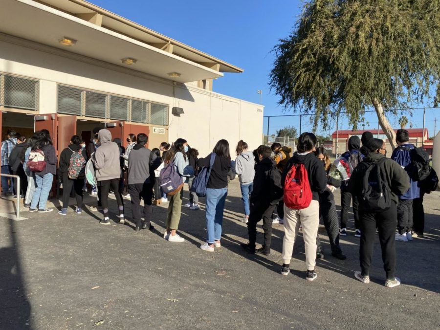 Seniors wait in line in front of the big gym to take their SAT.
