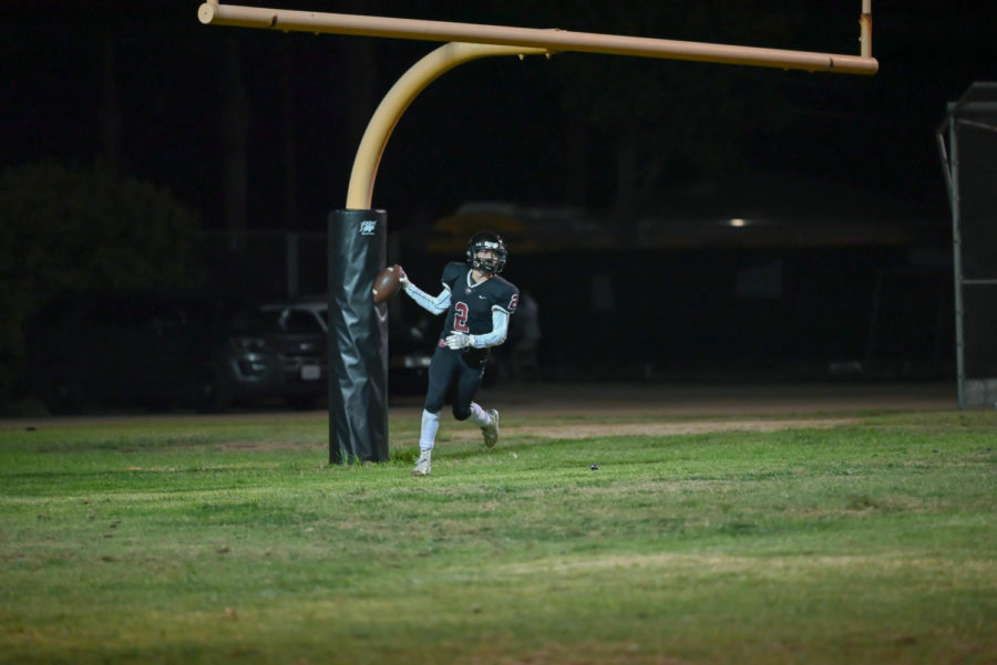 Yannis Boudiab (#2) gave some relief to the fans by scoring the only touchdown for the dog squad.