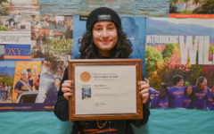 Editor-in-Chief Ani Tutunjyan poses with the Pacemaker award won during the previous year.