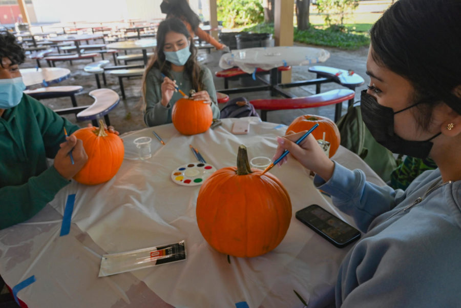 Hosted by EduCare, the pumpkin painting party took place in the cafeteria after school. Each participant receives a pumpkin of their choice and a variety of colors to paint with.