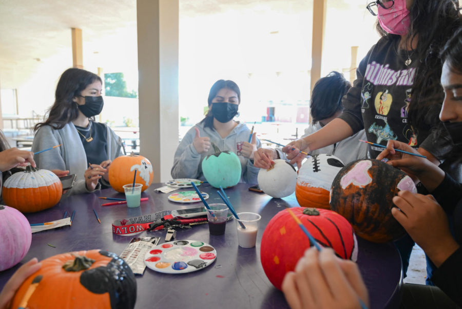 Pump, pump, pump It Up! The cheer team makes an appearance at the painting party to celebrate the spooky season. .
