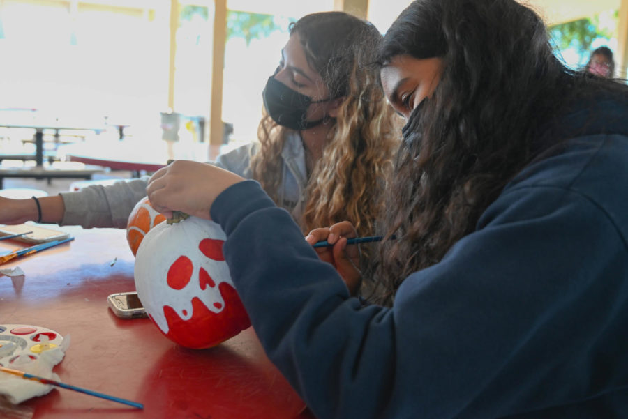 With seasonal music to boost Halloween spirit, students finish their design by 4:30 p.m., where photos of pumpkins and students are taken by EduCare for the contest.