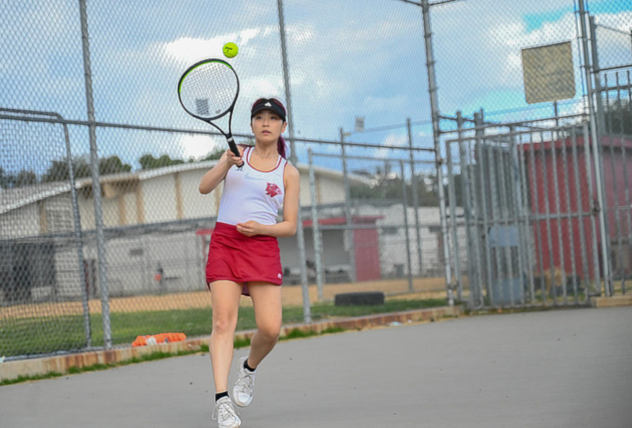 Singles player Irene Lee positions herself to successfully return a ball back to her opponent.