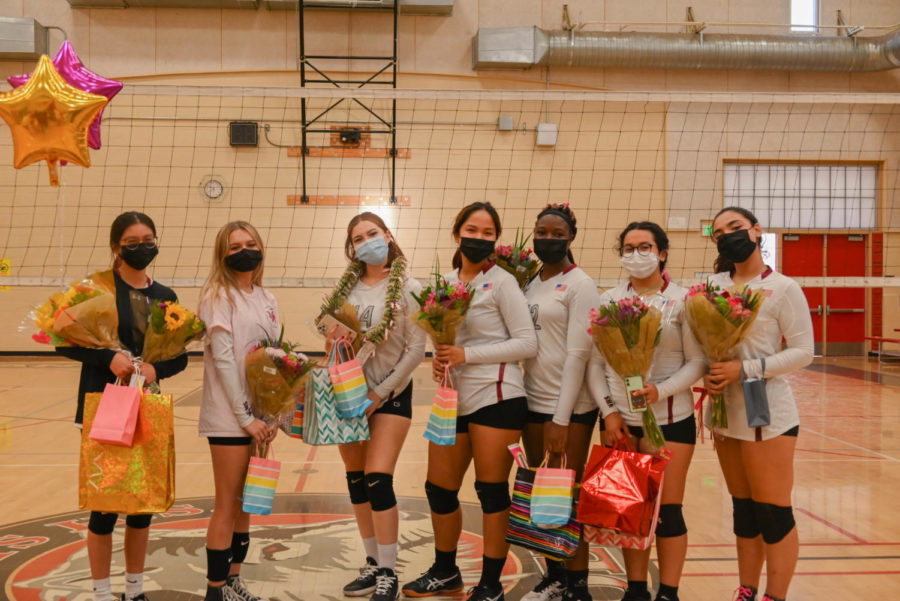 (L to R) Seniors Isabela Diaz, Alika Tsytsurina, Sarah Ramirez Guzman, Viviene Carvajal, Chidiogo Angel Chiawa ,Claudia Segura, and Alexis Golden are showered with gifts during the final game of their season at home.