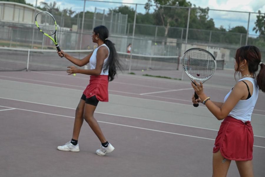 (L to R) Shriya Pattapu and Jasmine Cheysobhon warm up before their varsity doubles match against San Fernando.