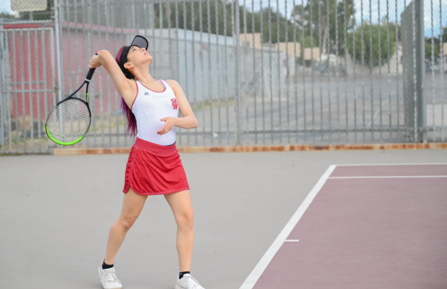 ACE: Varsity singles Irene Lee serves to her opponent and was one of the two Wolves to win her matchup.