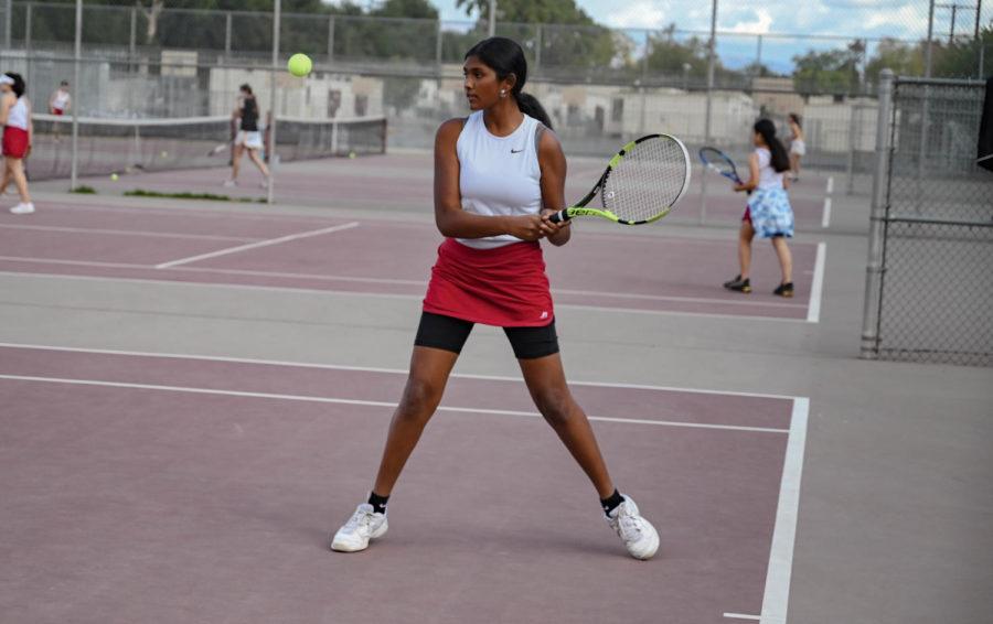Varsity Doubles Shriya Pattapu prepares to hit a backhand to her opponent.