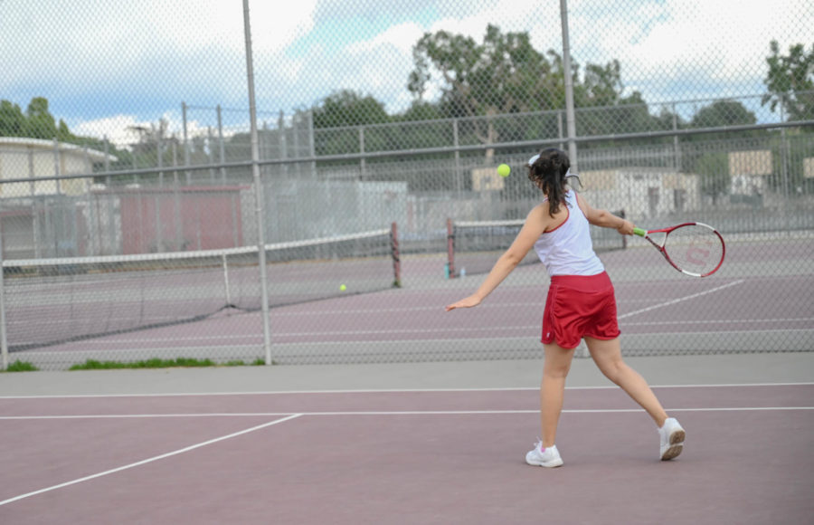 Jacqueline Recinos prepares to hit a forehand against the Tigers.