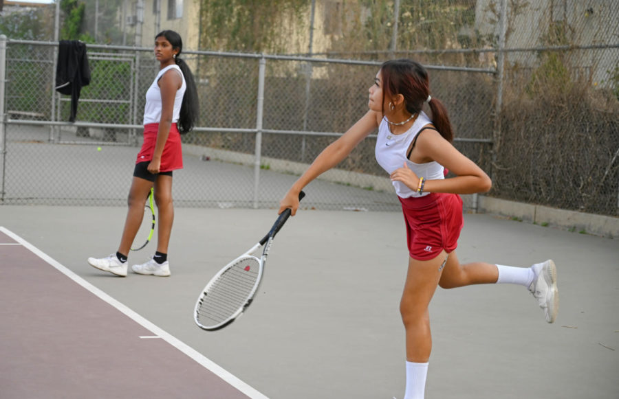 Jasmine Cheysobhon serves to the Tigers, as Shriya Pattapu looks on at the side. This doubles team ended up losing their match.