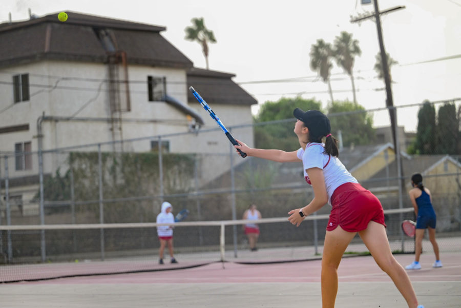 Varsity player Loc Handke plays in the top position of her team for the first time against Sylmar's number one and was victorious 10-8.